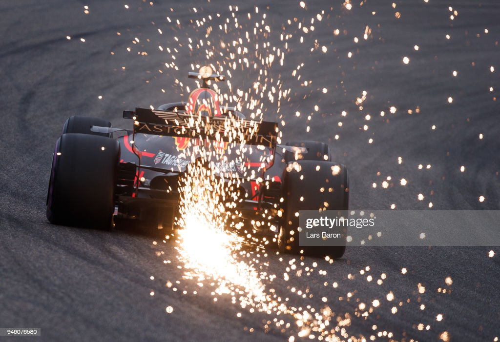 Sparks fly behind Daniel Ricciardo of Australia driving the (3) Aston Martin Red Bull Racing RB14 TAG Heuer on track during qualifying for the Formula One Grand Prix of China at Shanghai International Circuit on April 14, 2018 in Shanghai, China.