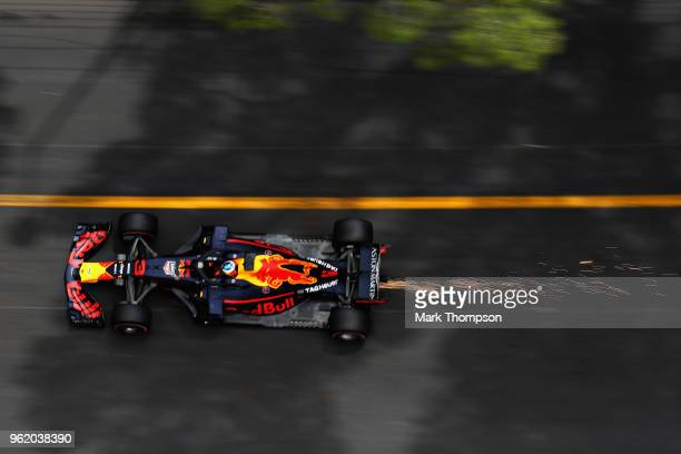 Sparks fly behind Daniel Ricciardo of Australia driving the Aston Martin Red Bull Racing RB14 TAG Heuer on track during practice for the Monaco...