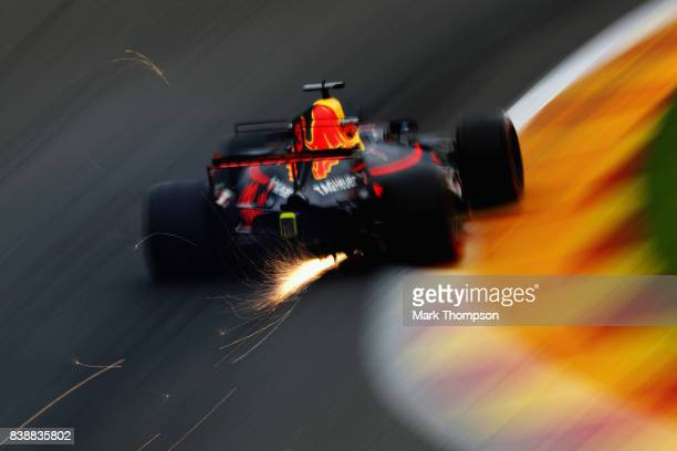 Sparks fly behind Daniel Ricciardo of Australia driving the Red Bull Racing Red BullTAG Heuer RB13 TAG Heuer on track during practice for the Formula...