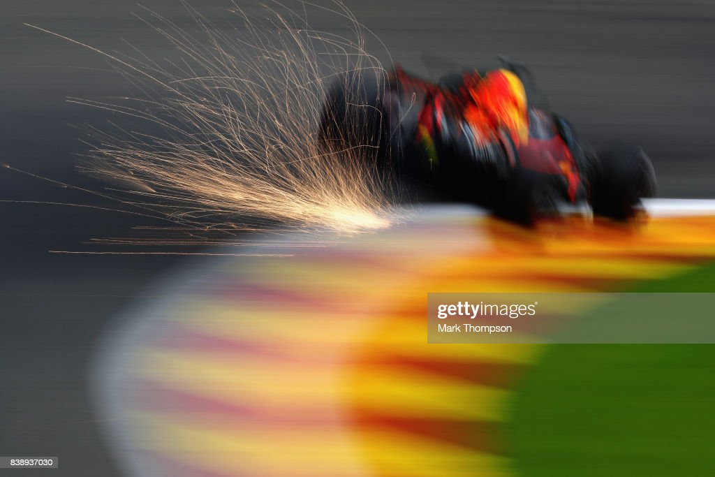 Sparks fly behind Daniel Ricciardo of Australia driving the (3) Red Bull Racing Red Bull-TAG Heuer RB13 TAG Heuer on track during practice for the Formula One Grand Prix of Belgium at Circuit de Spa-Francorchamps on August 25, 2017 in Spa, Belgium.