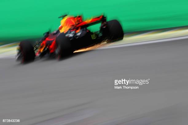 Sparks fly behind Daniel Ricciardo of Australia driving the Red Bull Racing Red BullTAG Heuer RB13 TAG Heuer on track during final practice for the...