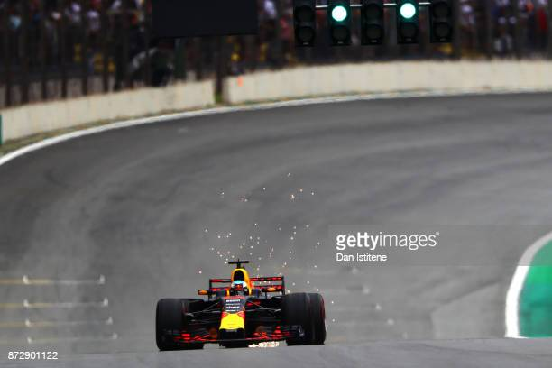 Sparks fly behind Daniel Ricciardo of Australia driving the Red Bull Racing Red BullTAG Heuer RB13 TAG Heuer on track during qualifying for the...