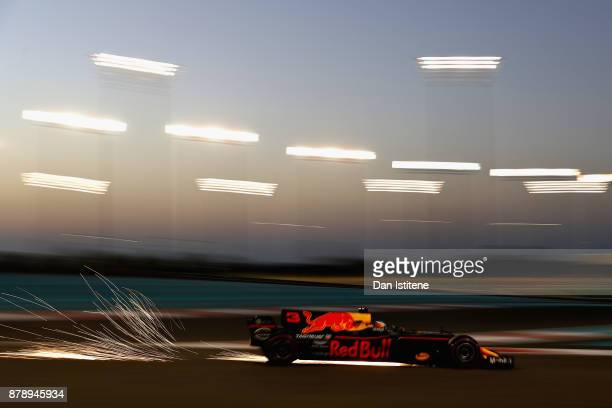Sparks fly behind Daniel Ricciardo of Australia driving the Red Bull Racing Red BullTAG Heuer RB13 TAG Heuer on track during qualifying for the Abu...