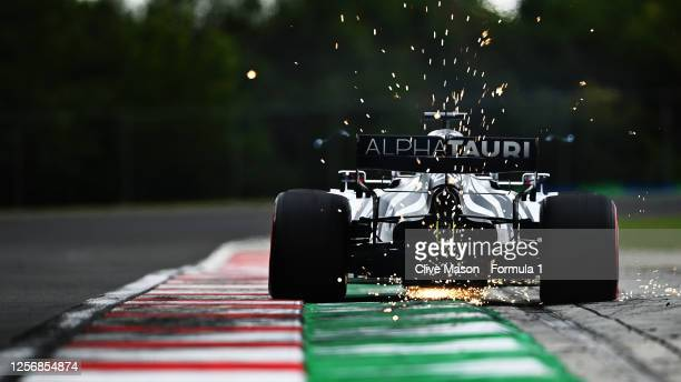 Sparks fly behind Daniil Kvyat of Russia driving the Scuderia AlphaTauri AT01 Honda during qualifying for the F1 Grand Prix of Hungary at Hungaroring...