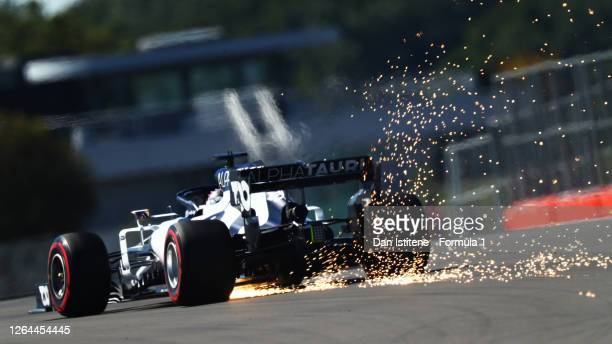 Sparks fly behind Daniil Kvyat of Russia driving the Scuderia AlphaTauri AT01 Honda during practice for the F1 70th Anniversary Grand Prix at...