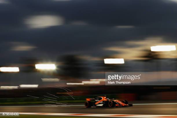 Sparks fly behind Fernando Alonso of Spain driving the McLaren Honda Formula 1 Team McLaren MCL32 on track during the Abu Dhabi Formula One Grand...
