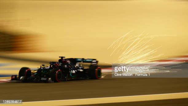 Sparks fly behind George Russell of Great Britain driving the Mercedes AMG Petronas F1 Team Mercedes W11 during practice ahead of the F1 Grand Prix...