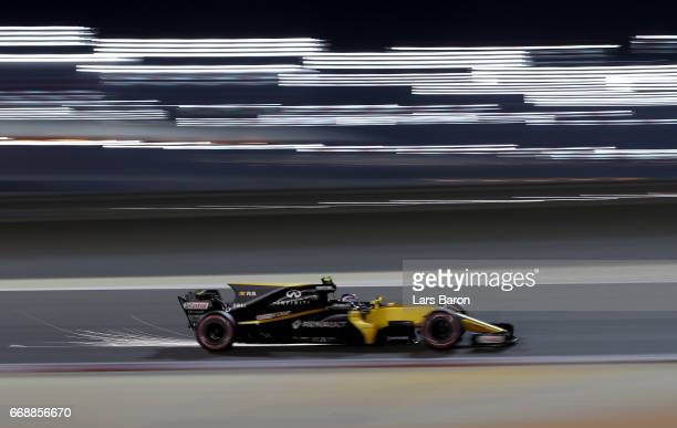Sparks fly behind Jolyon Palmer of Great Britain driving the Renault Sport Formula One Team Renault RS17 on track during qualifying for the Bahrain...