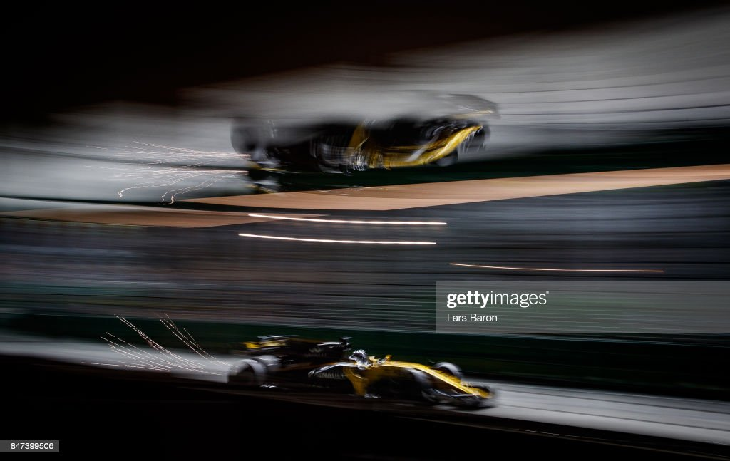 Sparks fly behind Jolyon Palmer of Great Britain driving the (30) Renault Sport Formula One Team Renault RS17 on track during practice for the Formula One Grand Prix of Singapore at Marina Bay Street Circuit on September 15, 2017 in Singapore.