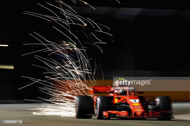Sparks fly behind Kimi Raikkonen of Finland driving the Scuderia Ferrari SF71H on track during practice for the Formula One Grand Prix of Singapore...