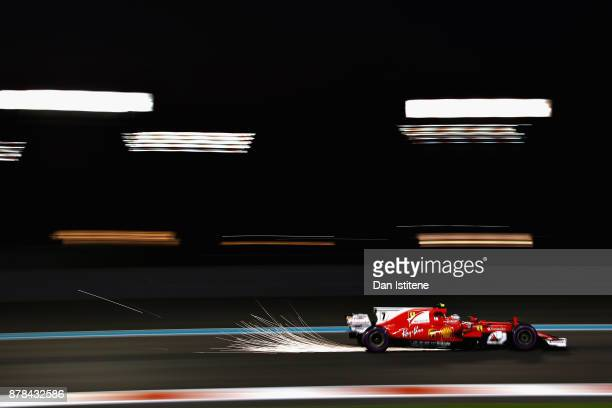 Sparks fly behind Kimi Raikkonen of Finland driving the Scuderia Ferrari SF70H on track during practice for the Abu Dhabi Formula One Grand Prix at...