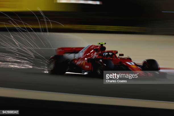 Sparks fly behind Kimi Raikkonen of Finland driving the Scuderia Ferrari SF71H on track during practice for the Bahrain Formula One Grand Prix at...