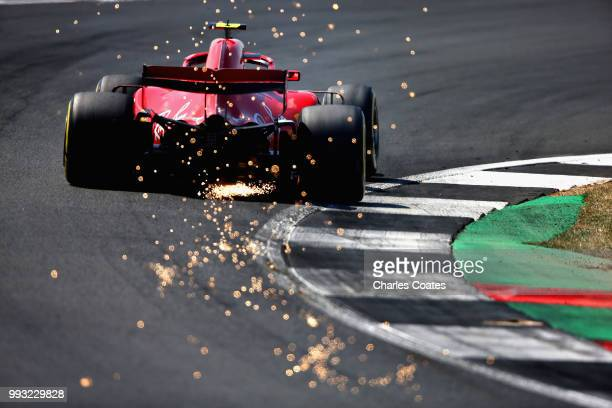 Sparks fly behind Kimi Raikkonen of Finland driving the Scuderia Ferrari SF71H on track during final practice for the Formula One Grand Prix of Great...