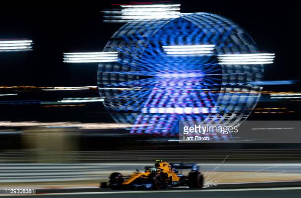 Sparks fly behind Lando Norris of Great Britain driving the McLaren F1 Team MCL34 Renault on track during qualifying for the F1 Grand Prix of Bahrain...