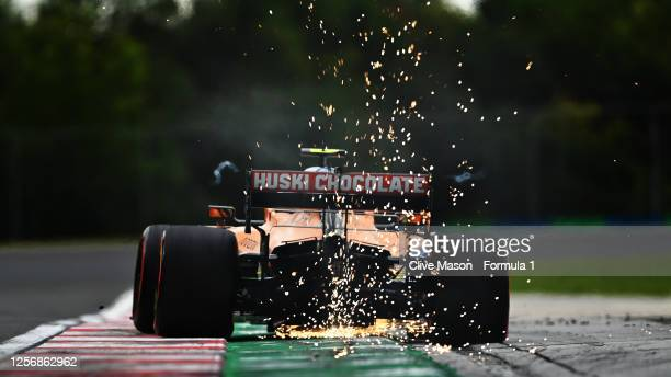 Sparks fly behind Lando Norris of Great Britain driving the McLaren F1 Team MCL35 Renault during qualifying for the F1 Grand Prix of Hungary at...