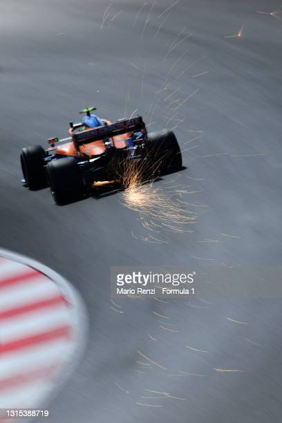 Sparks fly behind Lando Norris of Great Britain driving the McLaren F1 Team MCL35M Mercedes during practice ahead of the F1 Grand Prix of Portugal at...