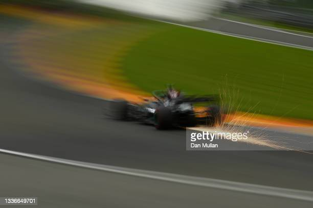 Sparks fly behind Lewis Hamilton of Great Britain driving the Mercedes AMG Petronas F1 Team Mercedes W12 during practice ahead of the F1 Grand Prix...