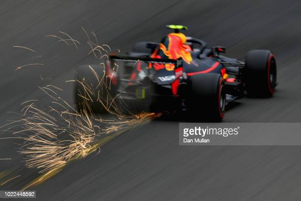 Sparks fly behind Max Verstappen of the Netherlands driving the Aston Martin Red Bull Racing RB14 TAG Heuer on track during practice for the Formula...