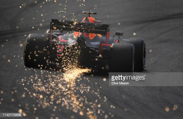 Sparks fly behind Max Verstappen of the Netherlands driving the Aston Martin Red Bull Racing RB15 on track during practice for the F1 Grand Prix of...