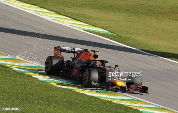 Sparks fly behind Max Verstappen of the Netherlands driving the Aston Martin Red Bull Racing RB15 on track during qualifying for the F1 Grand Prix of...
