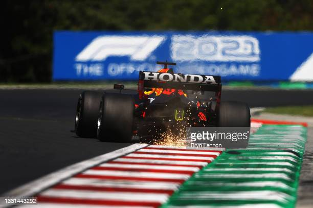 Sparks fly behind Max Verstappen of the Netherlands driving the Red Bull Racing RB16B Honda during practice ahead of the F1 Grand Prix of Hungary at...