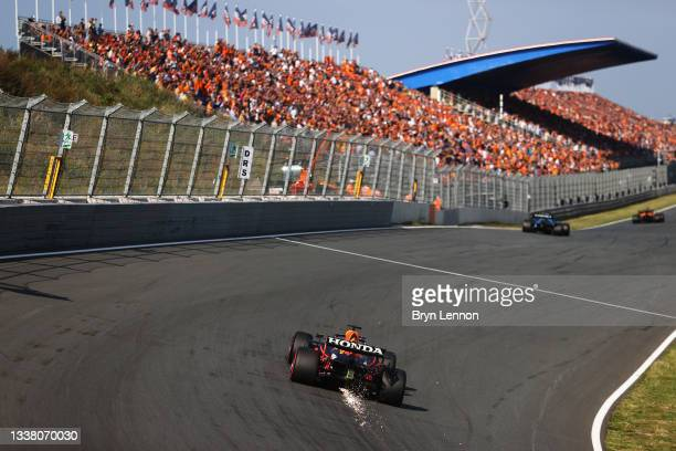 Sparks fly behind Max Verstappen of the Netherlands driving the Red Bull Racing RB16B Honda during practice ahead of the F1 Grand Prix of The...