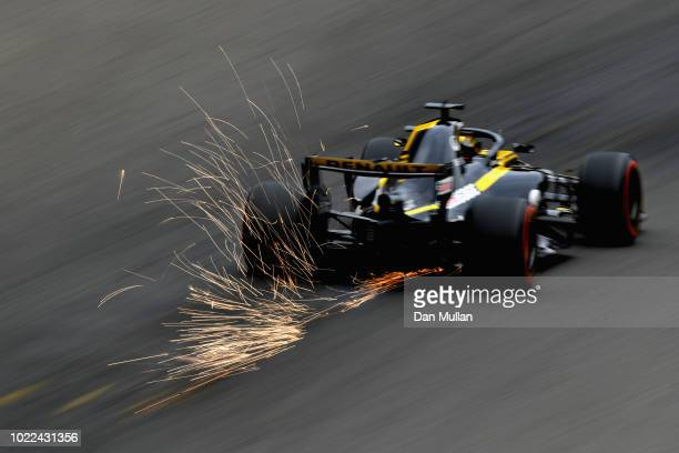 Sparks fly behind Nico Hulkenberg of Germany driving the Renault Sport Formula One Team RS18 on track during practice for the Formula One Grand Prix...