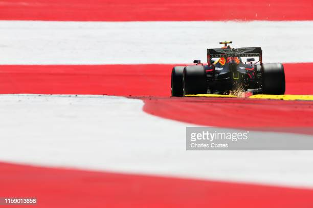 Sparks fly behind Pierre Gasly of France driving the Aston Martin Red Bull Racing RB15 on track during final practice for the F1 Grand Prix of...