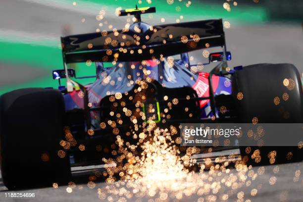 Sparks fly behind Pierre Gasly of France driving the Scuderia Toro Rosso STR14 Honda on track during the F1 Grand Prix of Brazil at Autodromo Jose...