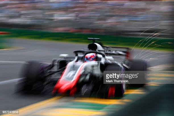 Sparks fly behind Romain Grosjean of France driving the Haas F1 Team VF-18 Ferrari on track during qualifying for the Australian Formula One Grand...