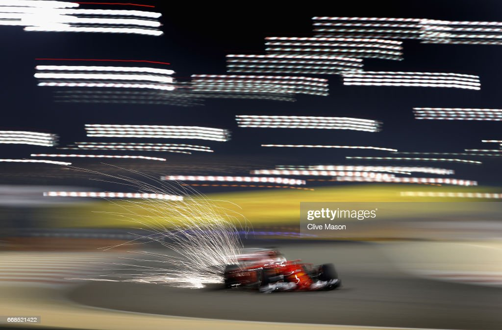 Sparks fly behind Sebastian Vettel of Germany driving the (5) Scuderia Ferrari SF70H on track during practice for the Bahrain Formula One Grand Prix at Bahrain International Circuit on April 14, 2017 in Bahrain, Bahrain.