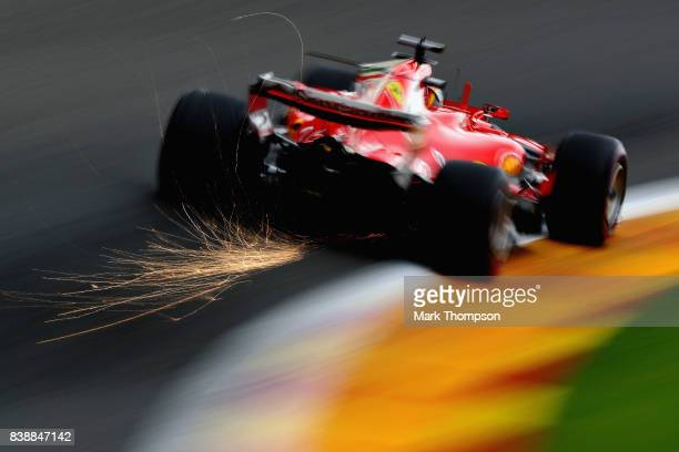 Sparks fly behind Sebastian Vettel of Germany driving the Scuderia Ferrari SF70H on track during practice for the Formula One Grand Prix of Belgium...