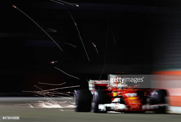 Sparks fly behind Sebastian Vettel of Germany driving the Scuderia Ferrari SF70H on track during qualifying for the Formula One Grand Prix of...