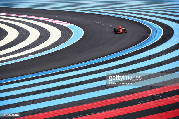 Sparks fly behind Sebastian Vettel of Germany driving the Scuderia Ferrari SF71H on track during final practice for the Formula One Grand Prix of...