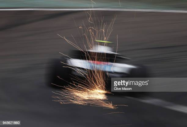 Sparks fly behind Sergey Sirotkin of Russia driving the Williams Martini Racing FW41 Mercedes on track during practice for the Formula One Grand Prix...