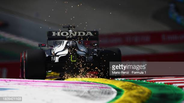 Sparks fly behind Yuki Tsunoda of Japan driving the Scuderia AlphaTauri AT02 Honda on track during practice ahead of the F1 Grand Prix of Styria at...