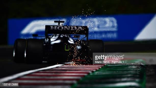 Sparks fly behind Yuki Tsunoda of Japan driving the Scuderia AlphaTauri AT02 Honda during final practice ahead of the F1 Grand Prix of Hungary at...