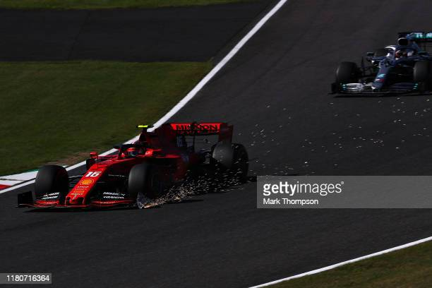 Sparks fly from the broken front wing of Charles Leclerc of Monaco driving the Scuderia Ferrari SF90 during the F1 Grand Prix of Japan at Suzuka...