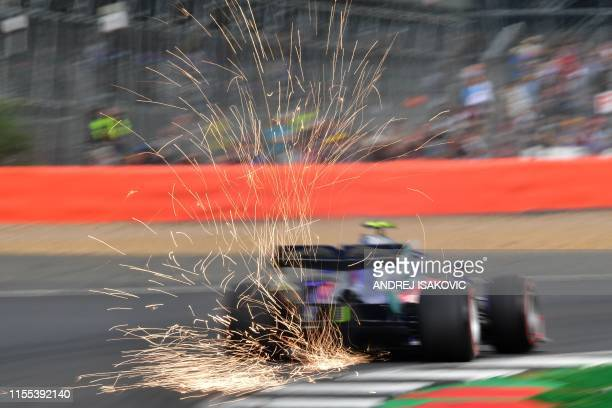 TOPSHOT Sparks fly from the car of Toro Rosso's Thai driver Alexander Albon during the qualifying session at Silverstone motor racing circuit in...