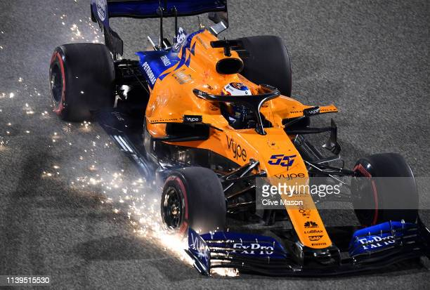 Sparks fly from the front wing of Carlos Sainz of Spain driving the McLaren F1 Team MCL34 Renault on track during the F1 Grand Prix of Bahrain at...