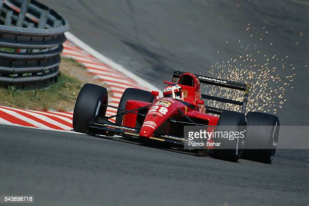 Sparks fly off the Ferrari Formula One racecar driven by Jean Alesi during the Belgian Grand Prix