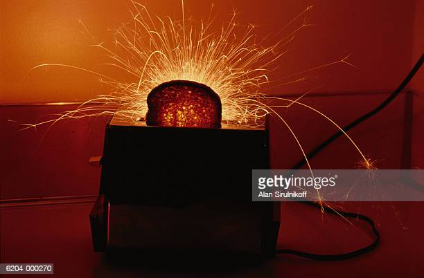 sparks flying from toaster - sirulnikoff stock photos and pictures