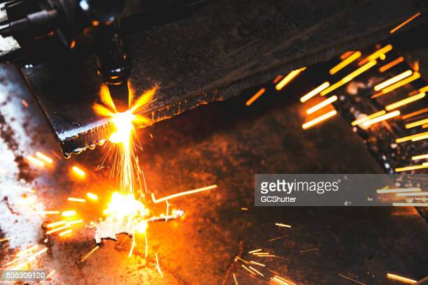 Sparks flying out from the sides of a plasma cutter