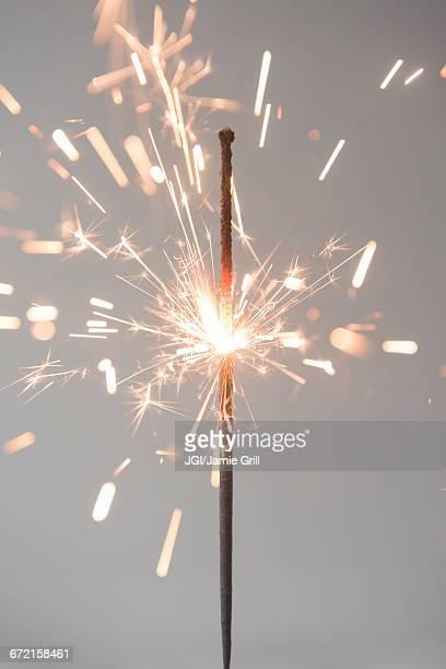 sparks on burning sparkler - sparkler stock pictures, royalty-free photos & images