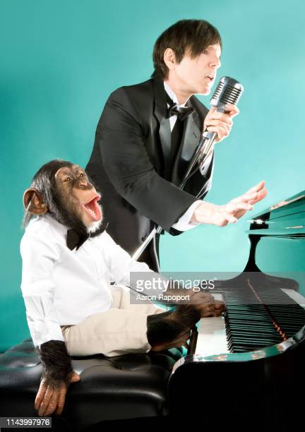 Sparks vocalist Russell Mael poses for a portrait with Susie the chimp in Hollywood, California