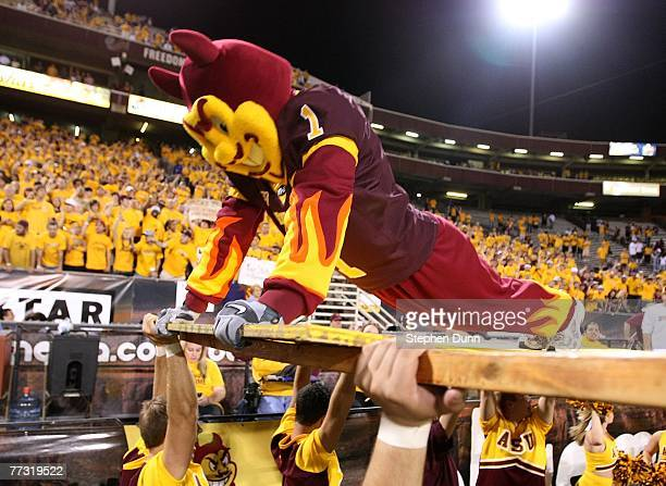 Sparky the Arizona State Sun Devils mascot does pushups in front of the student section after a Sun Devils' touchdown against the Washington Huskies...