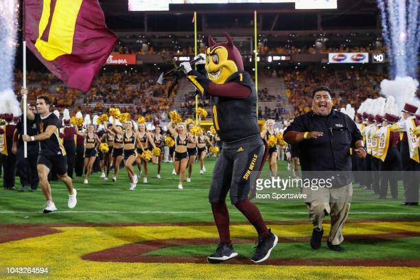 Sparky the Arizona State University mascot fires up the crowd before the college football game between the Oregon State Beavers and the Arizona State...