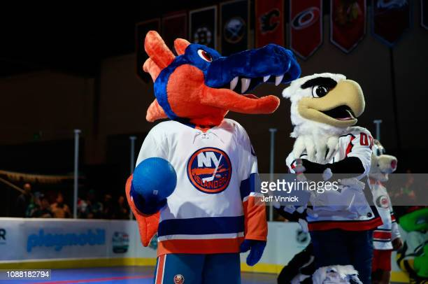 Sparky the Dragon of the New York Islanders and Slapshot of the Washington Capitals participate in the 2019 NHL AllStar Mascot Showdown on January 24...