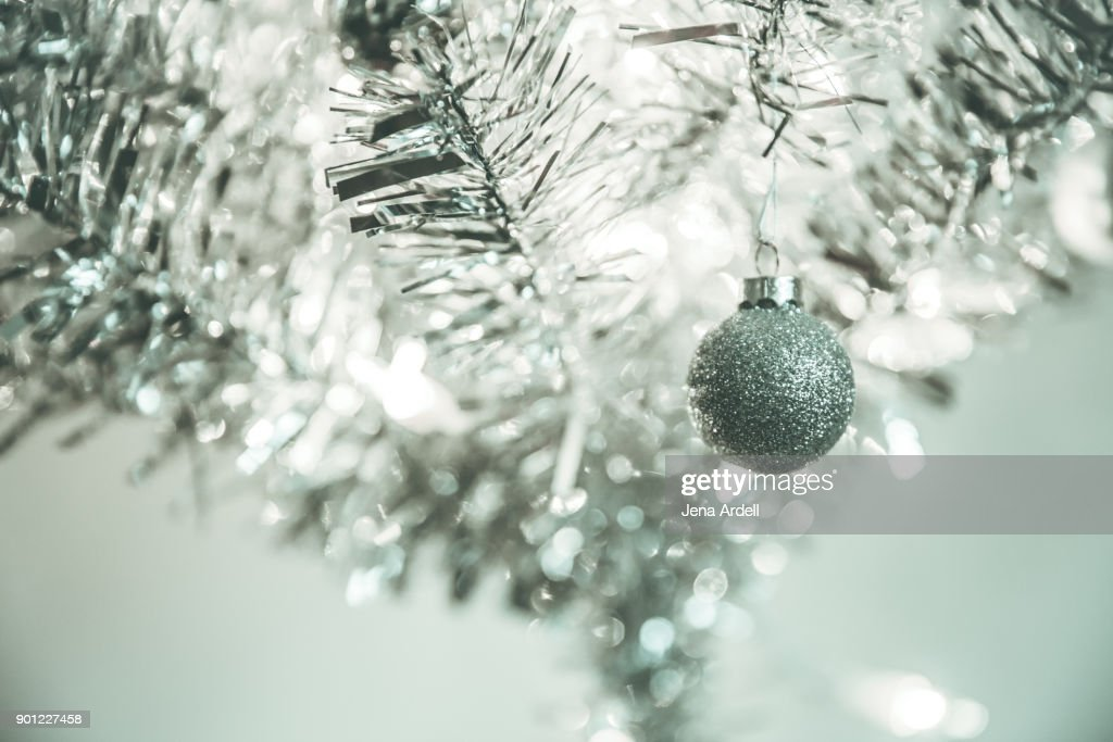 Sparse Christmas Tree Decorating.Sparse Christmas Tree With One Ornament High Res Stock Photo