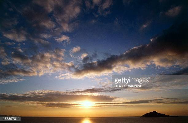 Sparse clouds at sunset over Cape Sounion Greece